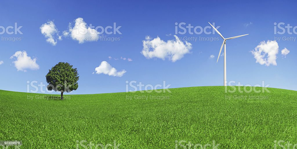 Lonely tree and wind turbine on a green field (XXXLarge) royalty-free stock photo