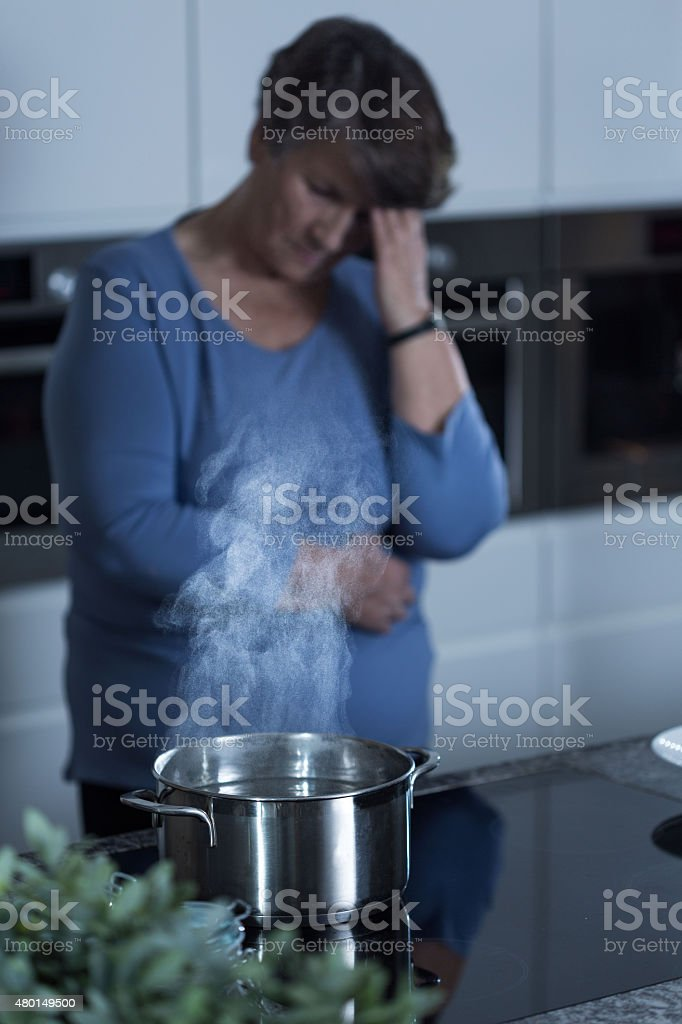 Lonely widow cooking stock photo