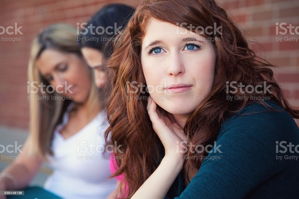 Lonely woman daydreaming stock photo