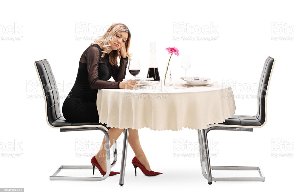 Lonely woman drinking wine stock photo