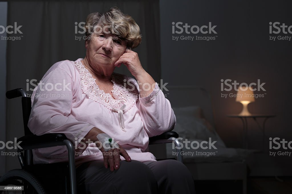 Lonely woman in rest home stock photo