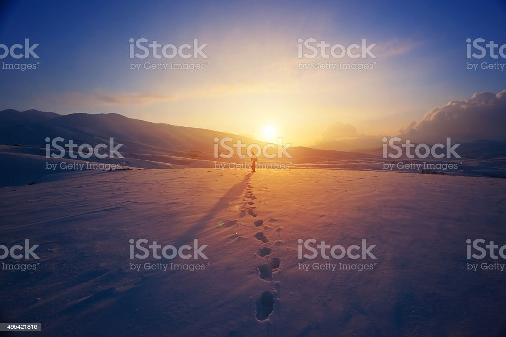 Lonely woman in the mountains stock photo