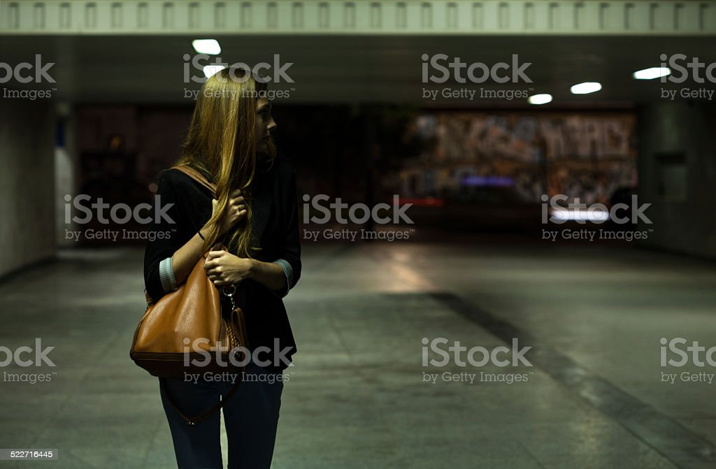 Lonely woman in the underpass stock photo