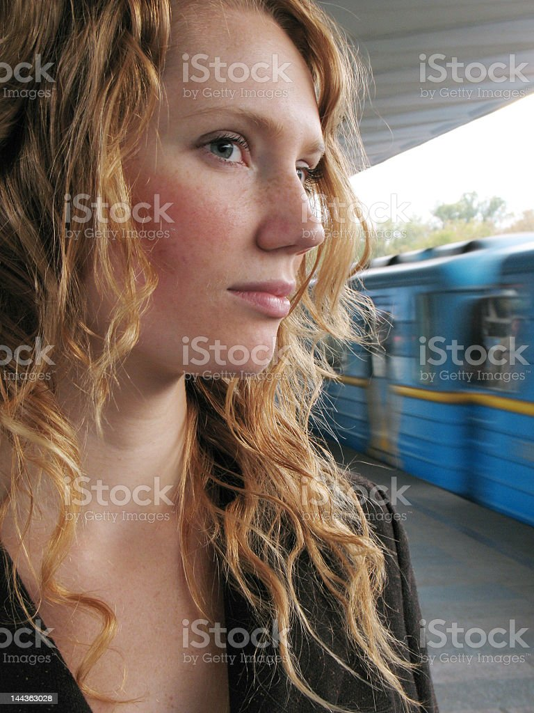lonely woman on subway station royalty-free stock photo