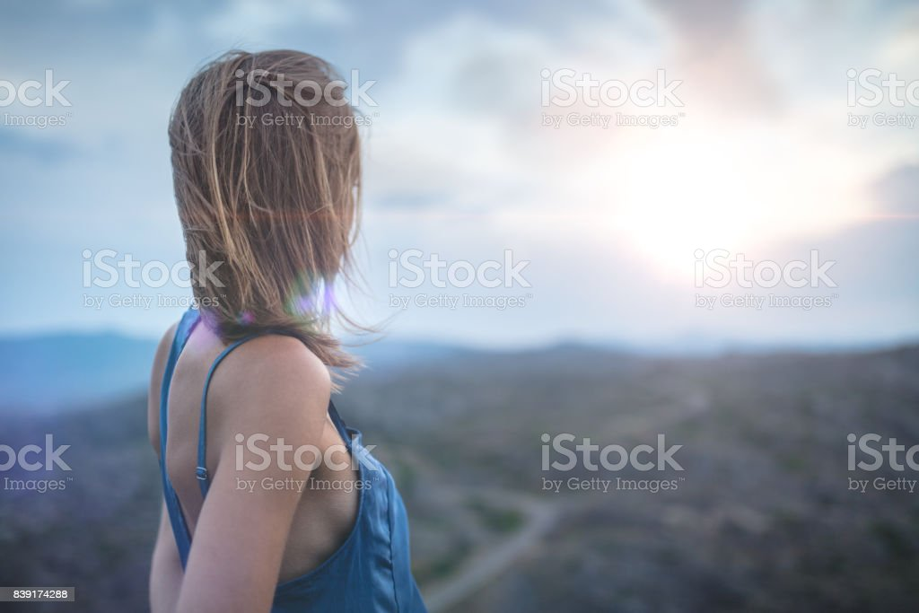Lonely woman outdoors stock photo