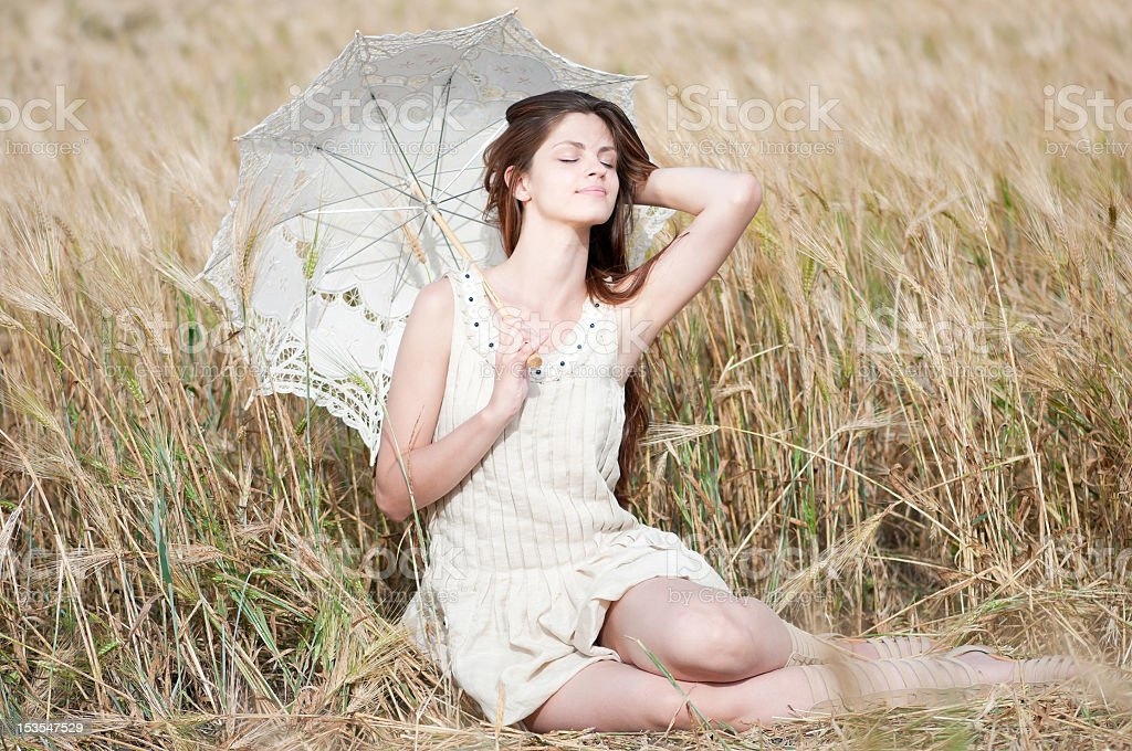 lonely woman sitting in wheat field royalty-free stock photo