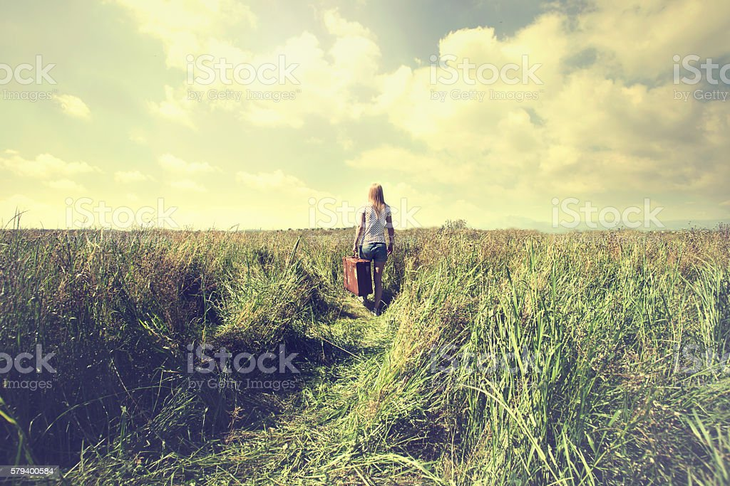 lonely woman takes a trip to a different life stock photo