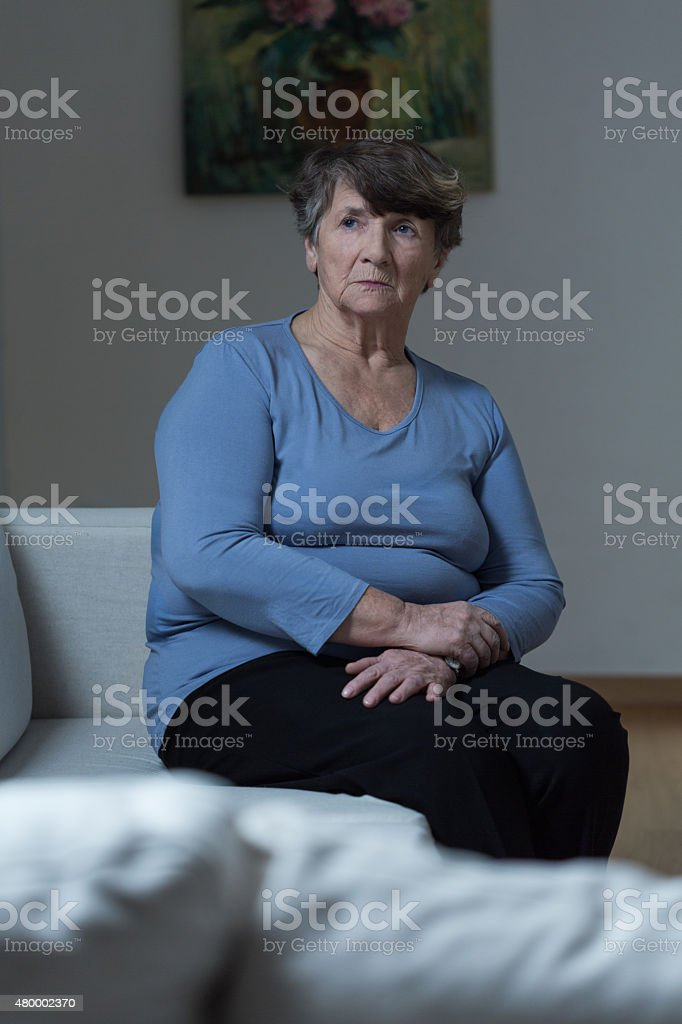 Lonely women in an empty house stock photo