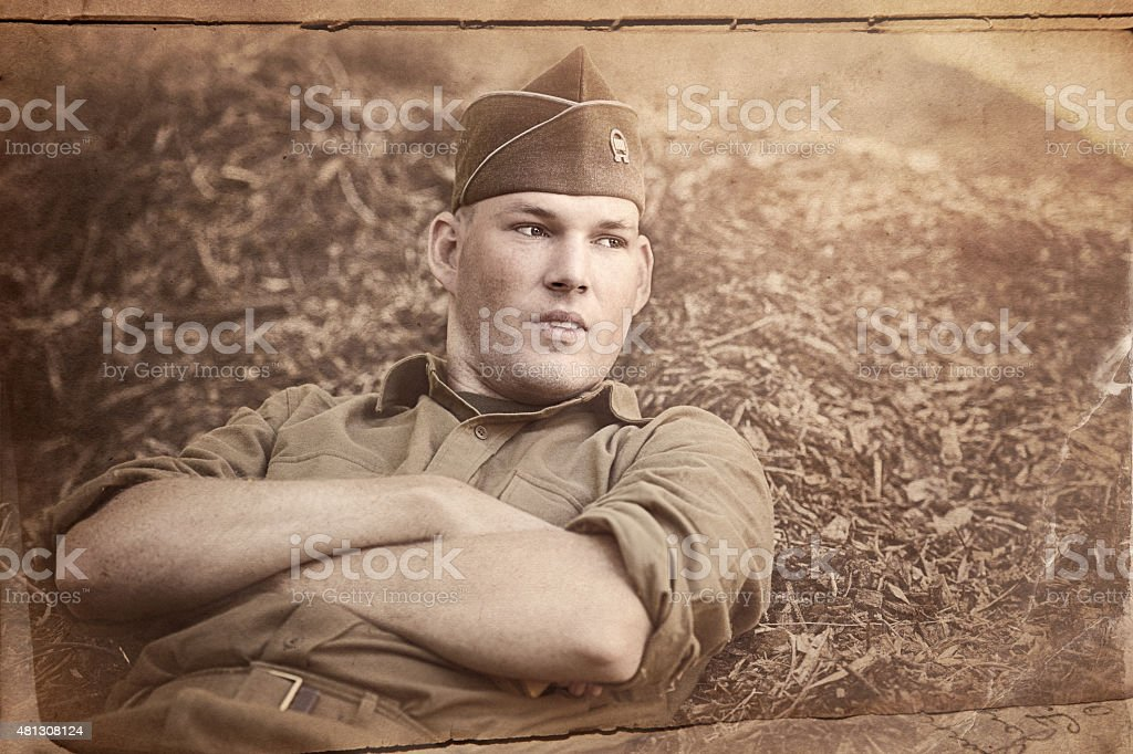 Lonely WWII Soldier - Thinking of Home And Loved Ones stock photo