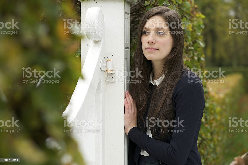 Lonely young woman outdoors in park royalty-free stock photo