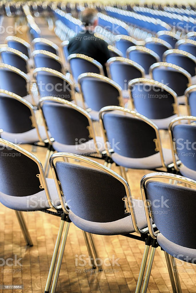 Single mature male person sitting in an auditorium. Toned picture.