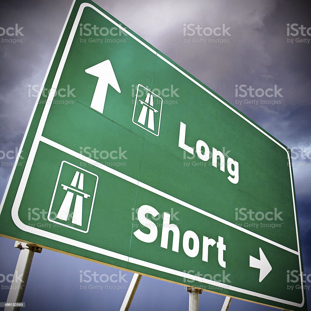 Long and short exits on highway sign stock photo