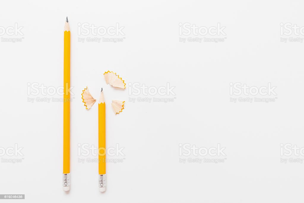 Long and short pencils with shavings on white stock photo