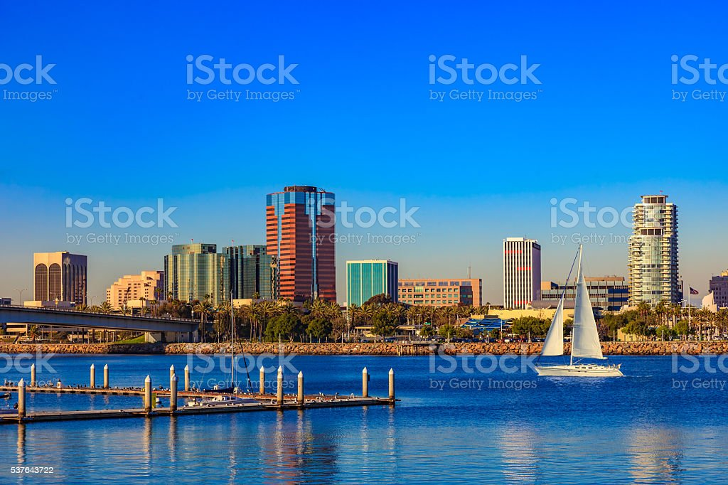 Long Beach Harbor with skyline and sailboat, CA stock photo
