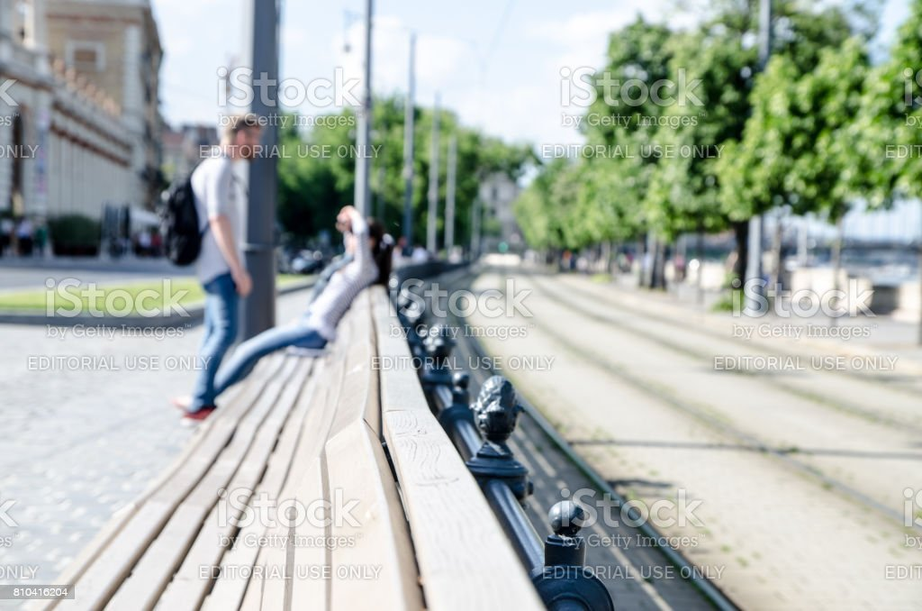 Long bench on the street stock photo