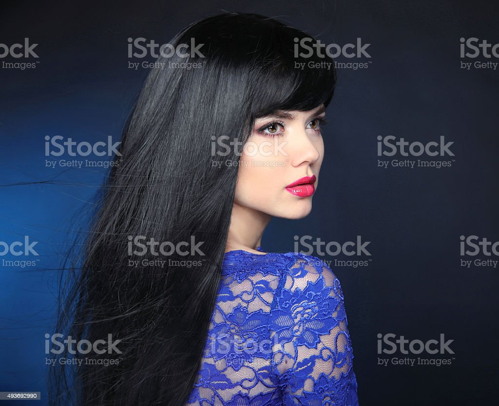 Long Black Hair. Beautiful model girl with healthy straight hairstyle stock photo