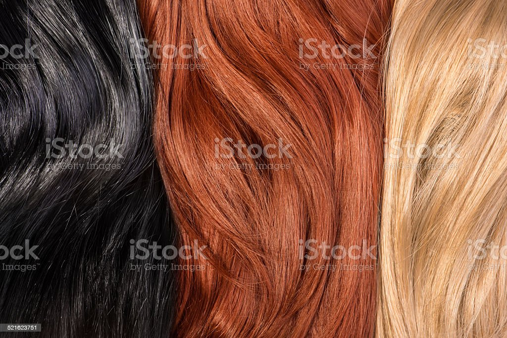 Long blond, black, red human shiny hair stock photo