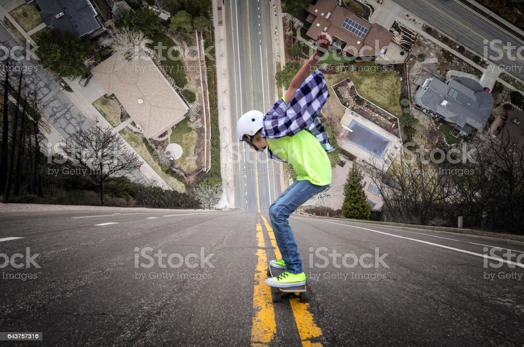 Long boarding down super steep hill stock photo