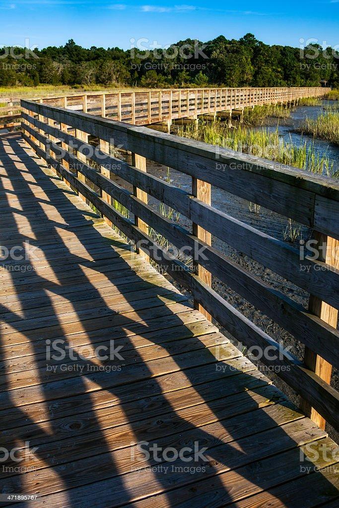 Long Boardwalk Platform over Marshland royalty-free stock photo