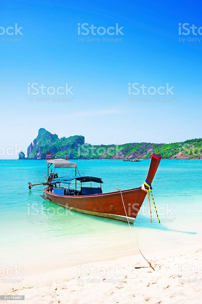 Long boat and tropical beach, Andaman Sea, Thailand stock photo