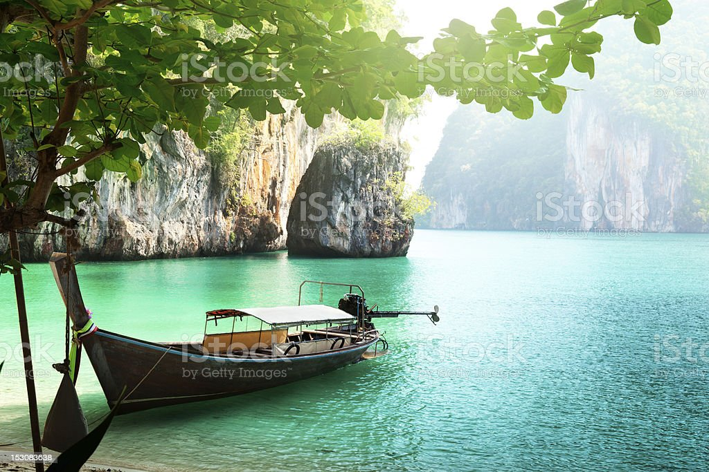 long boat on island in Thailand stock photo