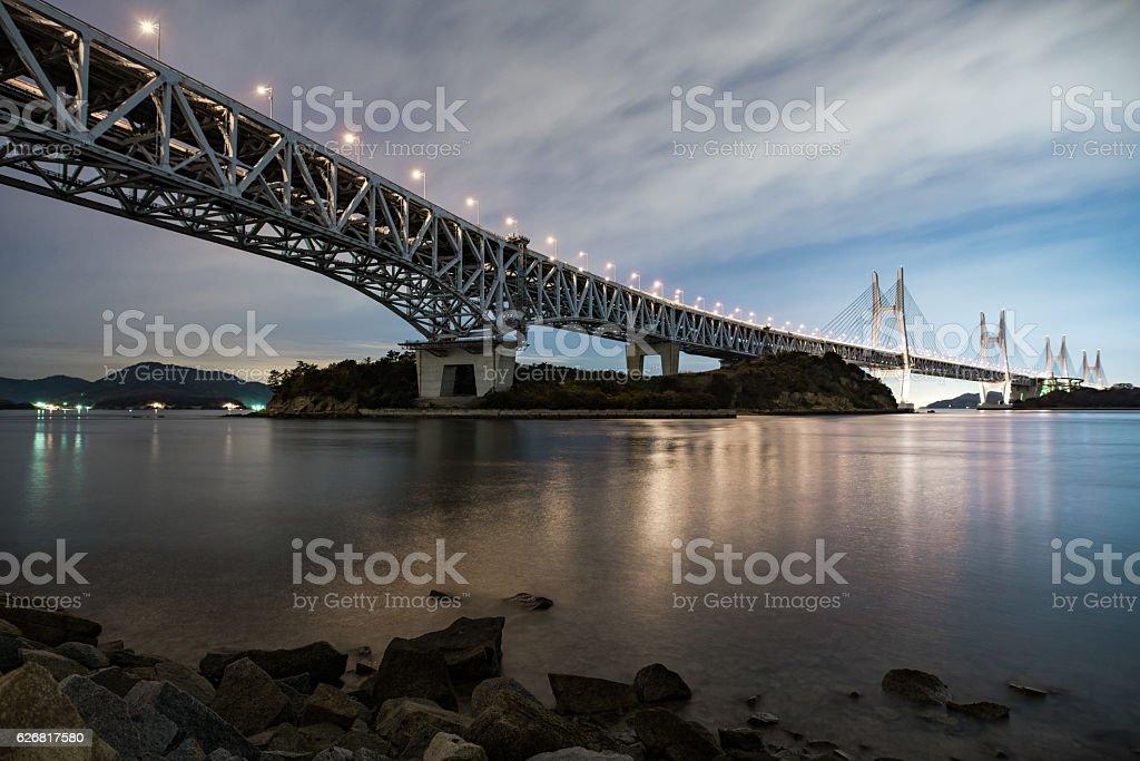 Long bridge illuminated at night stock photo