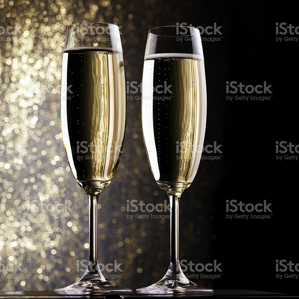 Long champagne flutes filled with champagne royalty-free stock photo