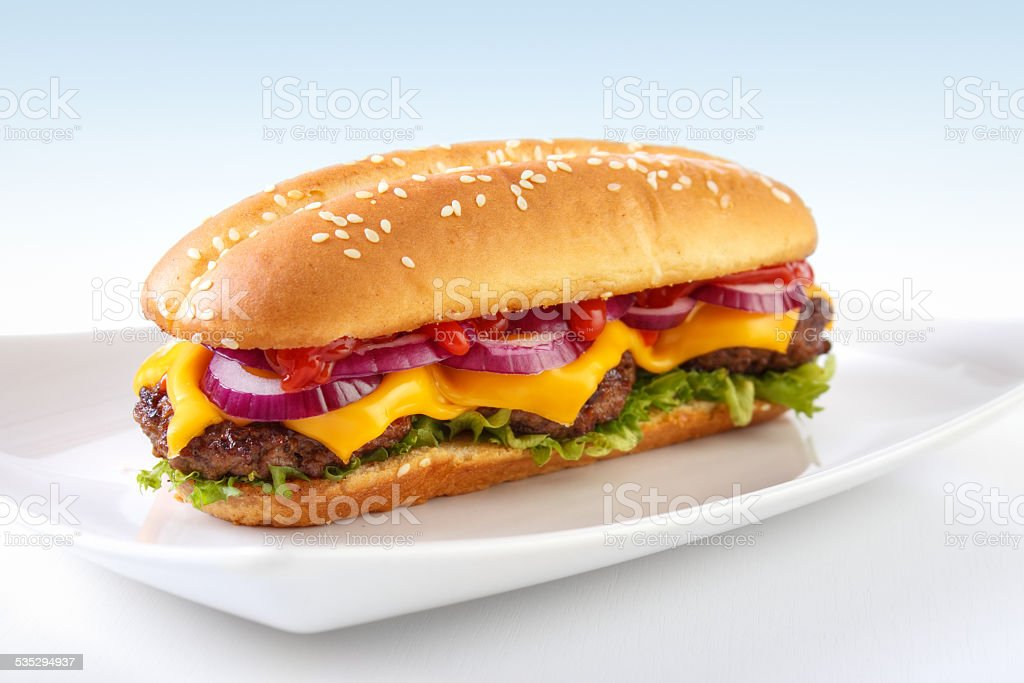 Long cheeseburger on white dish royalty-free stock photo