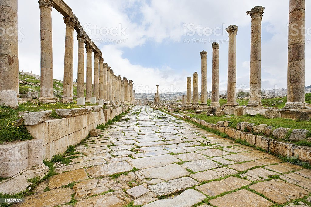 long colonnaded street in antique town Jerash stock photo