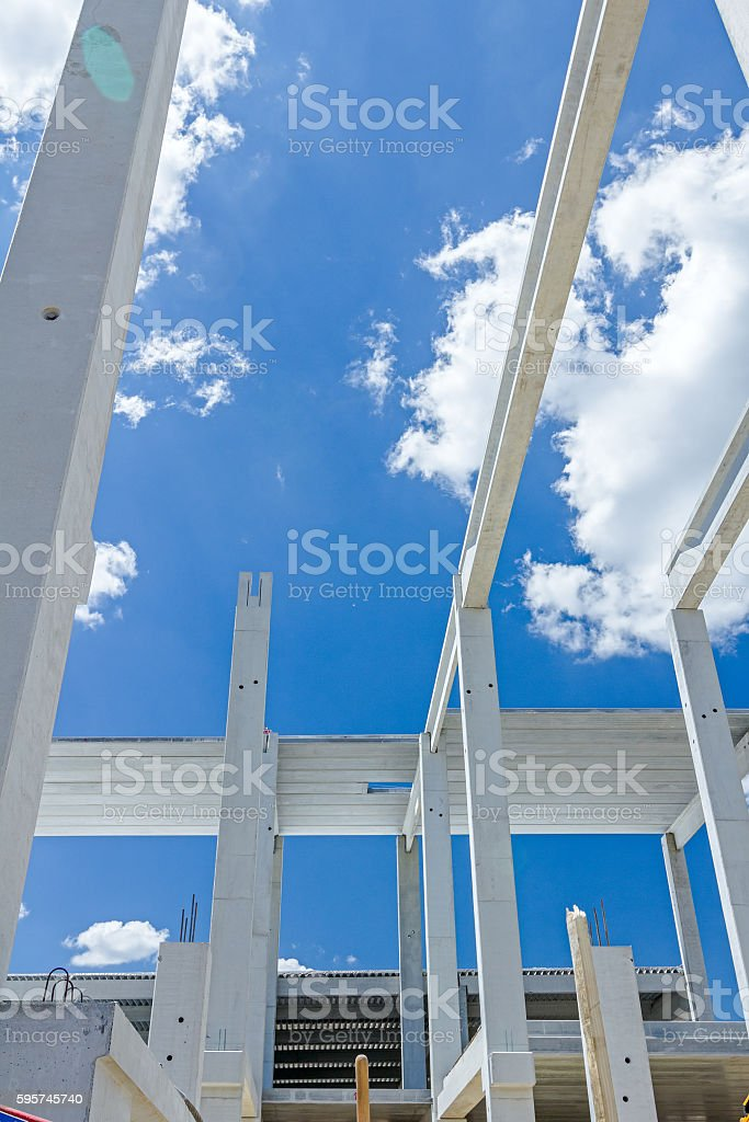 Long concrete pillars are going into beautiful sky. stock photo