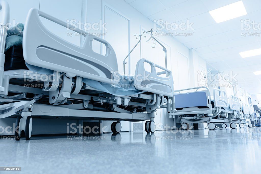 long corridor in hospital with surgical beds. stock photo