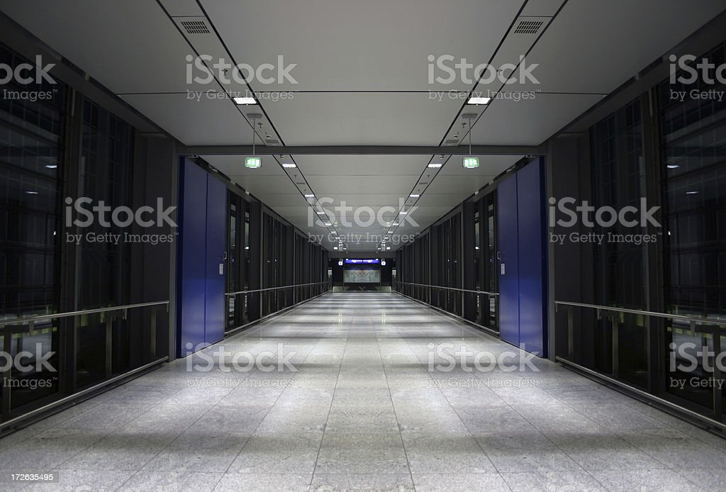 Long corridor with lights and blue panels royalty-free stock photo