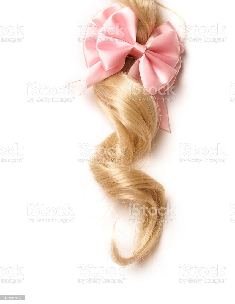 Long curly blonde lock of hair tied with pink bow royalty-free stock photo
