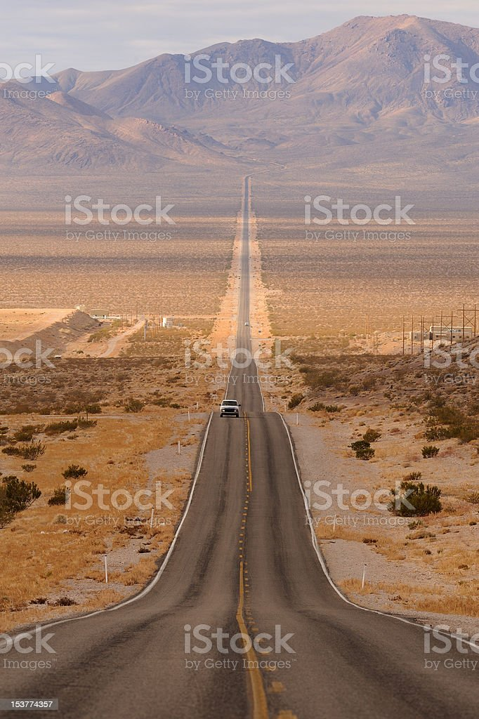 Long desert highway stock photo