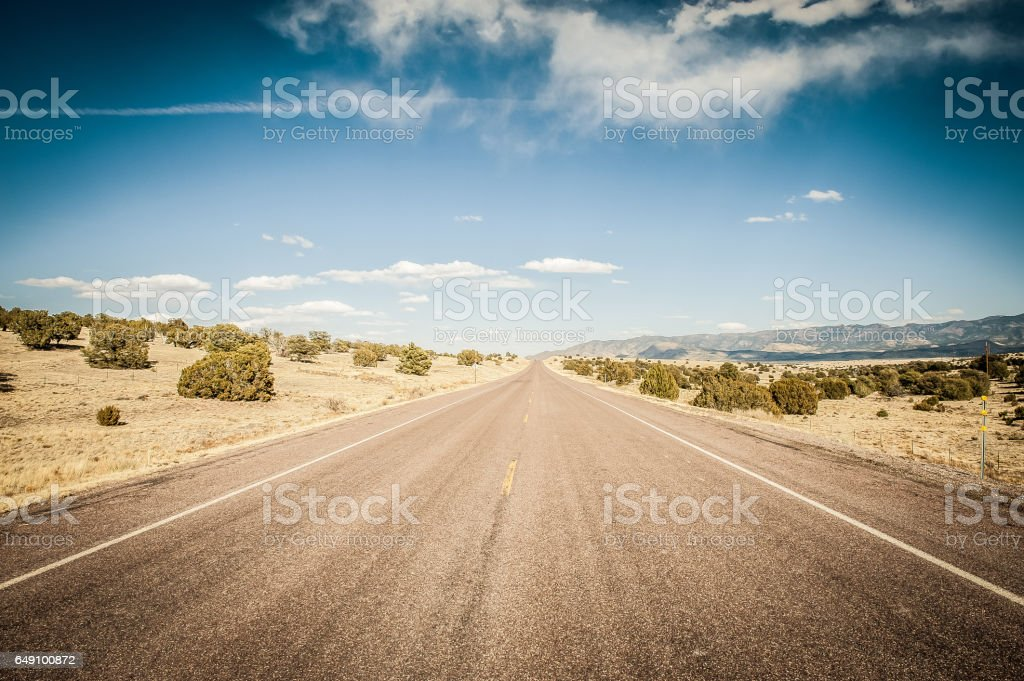 Long Desert Road in New Mexico stock photo