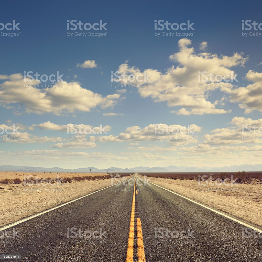 Long desert road stock photo