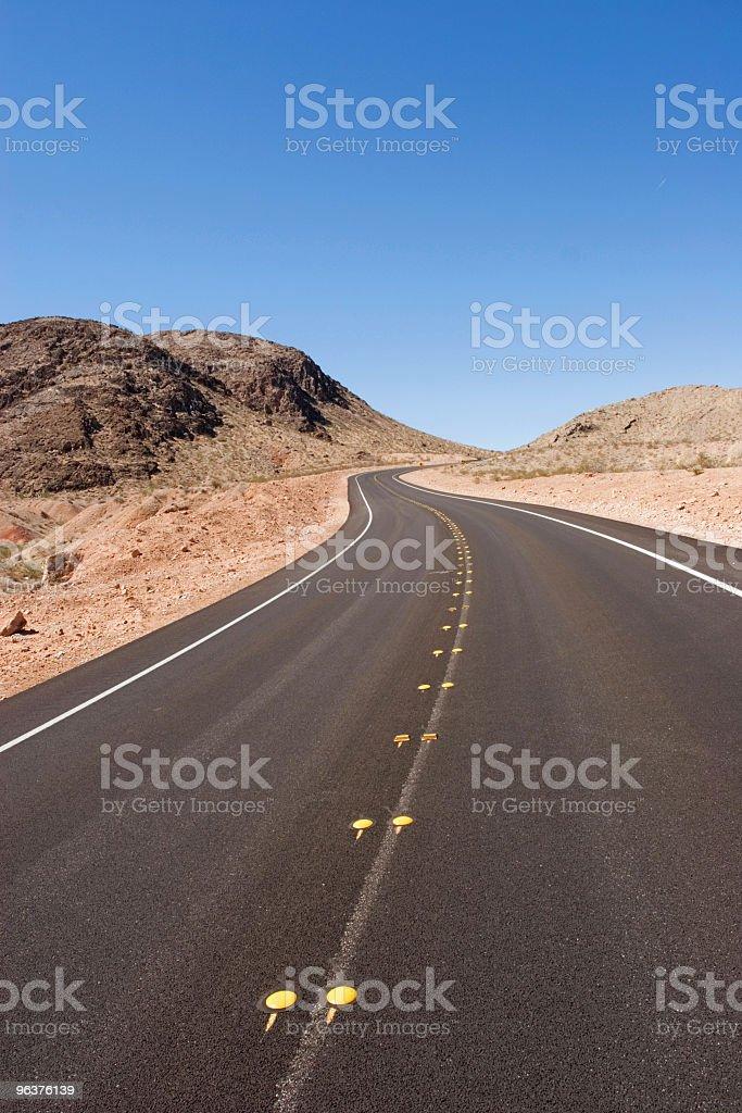 Long desert road stock photo