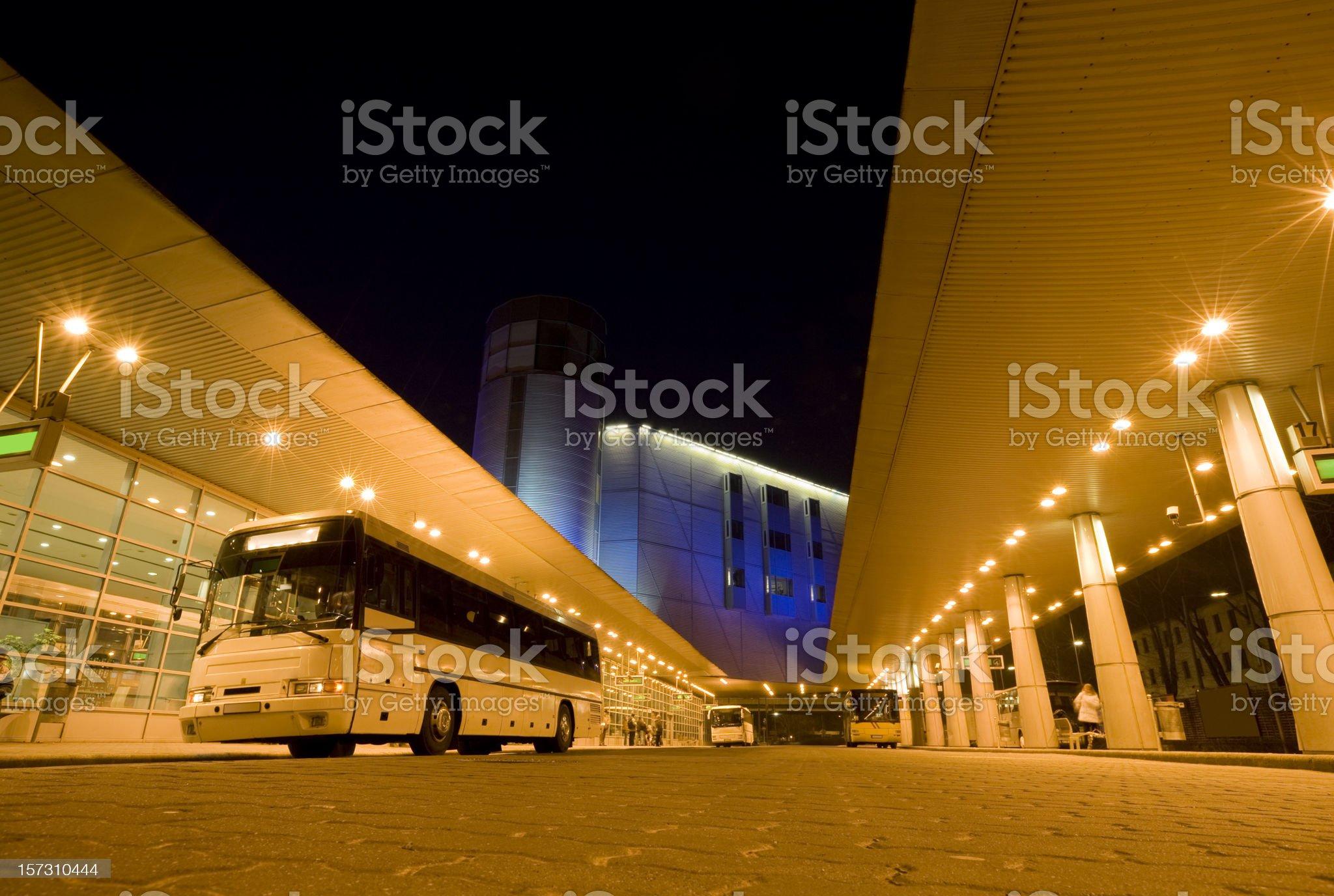Long Distance Bus Station Illuminated at Night royalty-free stock photo