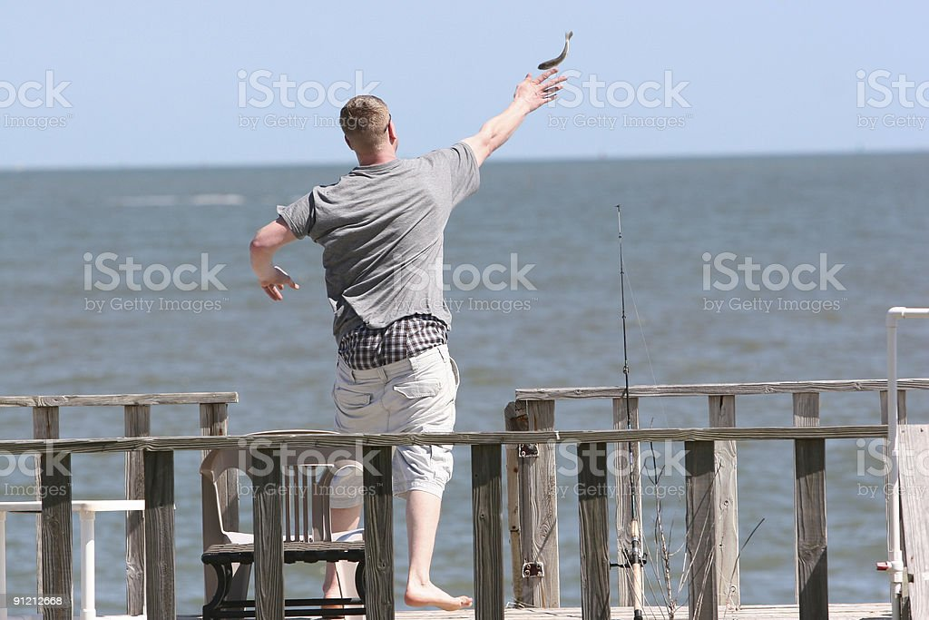 Long distance fish release stock photo