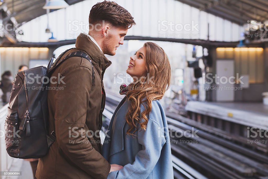 long distance relationship, couple at train station stock photo