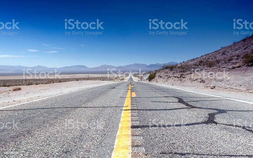 Long Distant Highway Under the Summer Sun Across Death Valley stock photo