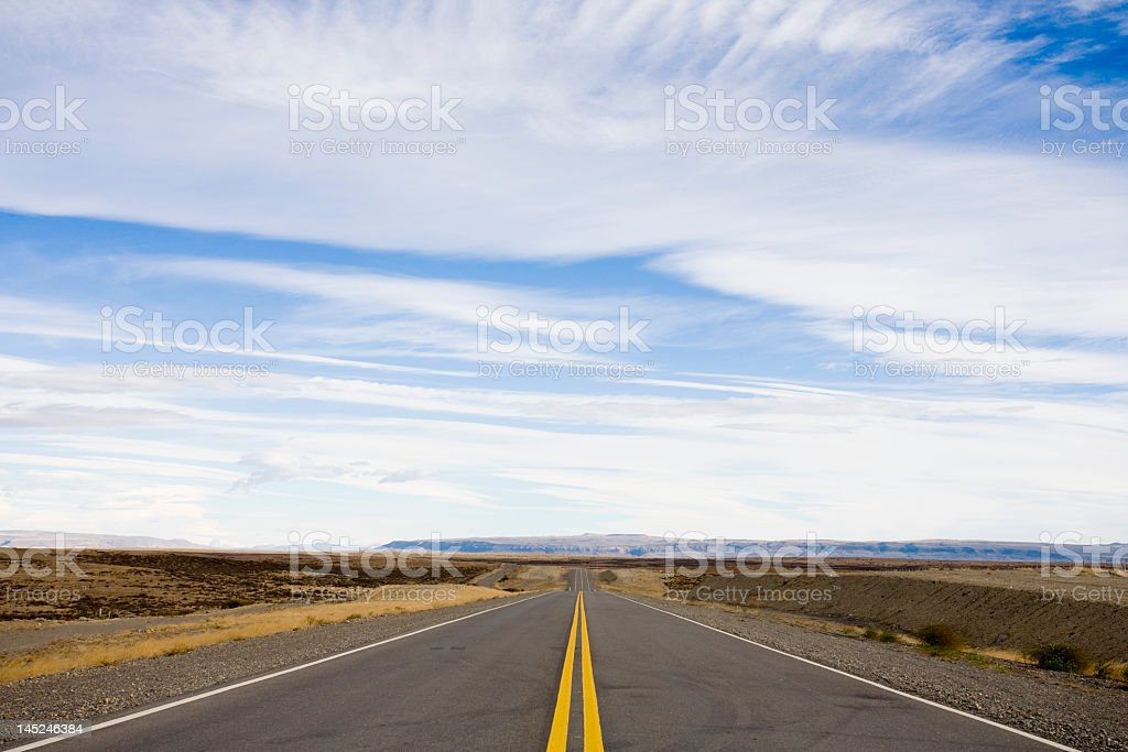 A long empty deserted road in America royalty-free stock photo