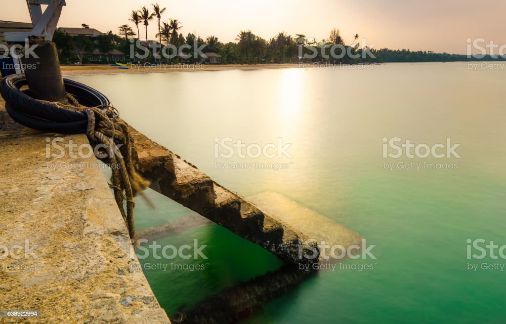 long explosure of pier step down in to the sea stock photo