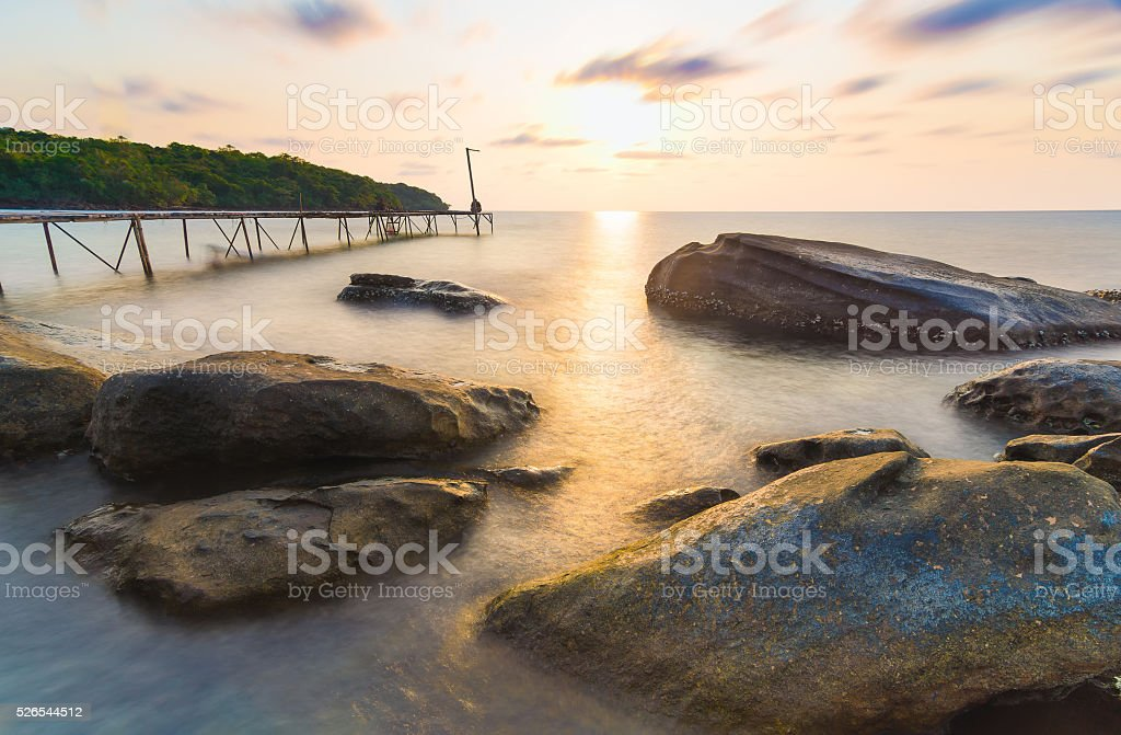 long explosure wood briged and smoothe clouds stock photo