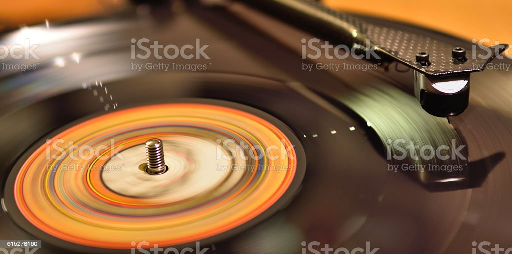 Long exposition of a vinyl spining on a turntable stock photo