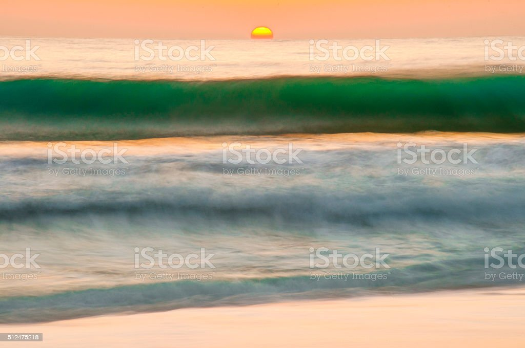 Long exposure at sunset time on the beach stock photo