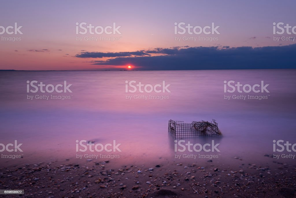 Long exposure crab cage sunset in the Bay stock photo