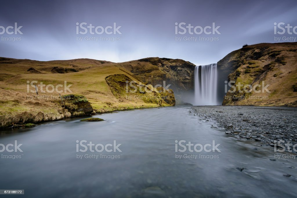 Long exposure effect in Skogafoss, the most popular waterfall in Iceland stock photo