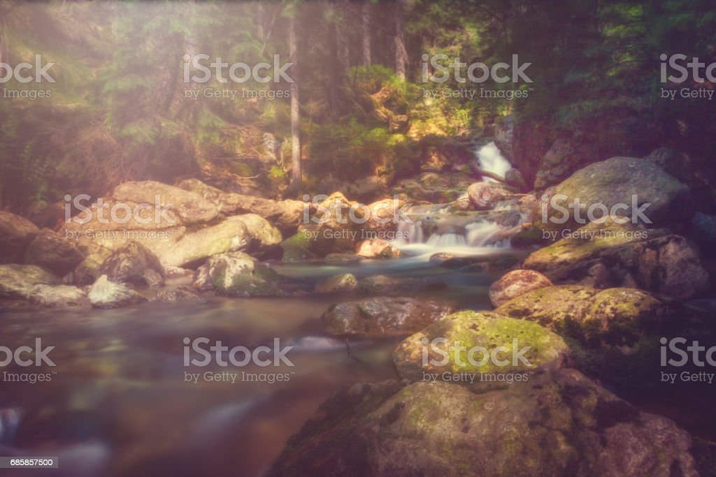 Long exposure from a little river with rocks stock photo