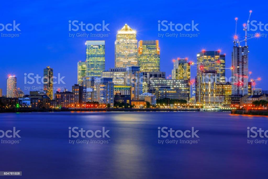 Long exposure, illuminated cityscape in Canary Wharf, London stock photo